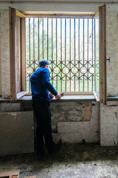 2015 - Izidor looking out his old window at orphanage