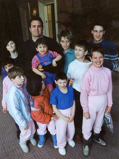 John Upton with several orphans he rescued