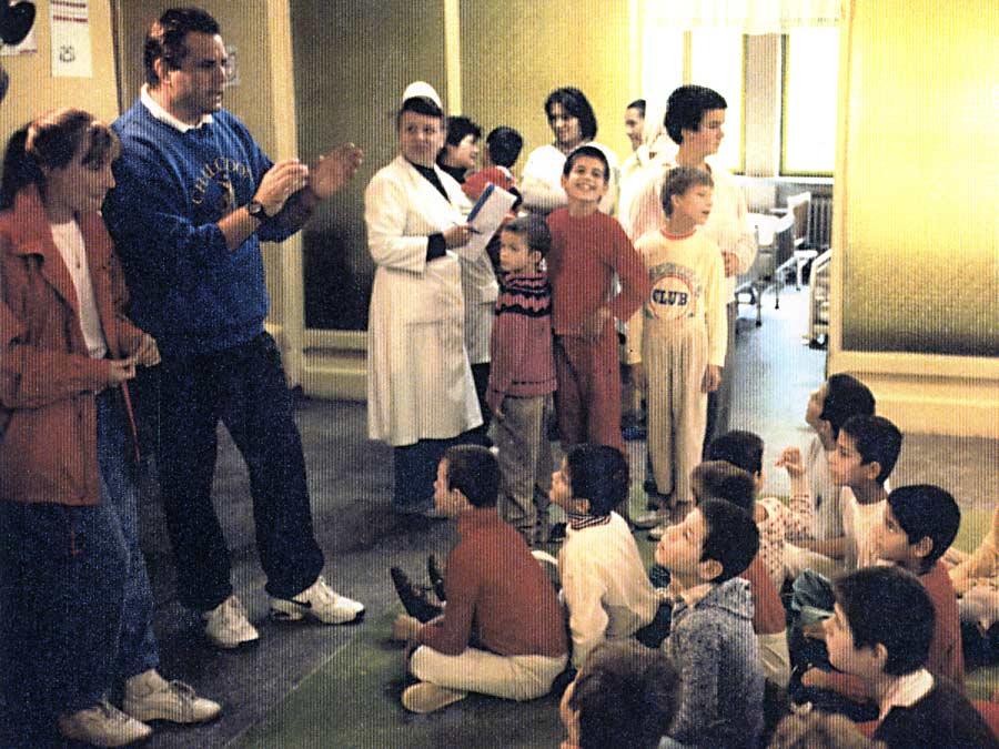 John choosing children at orphanage