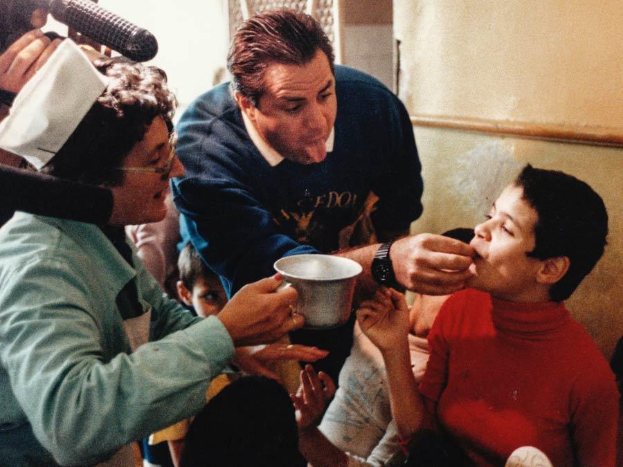 John feeding Elena at orphanage
