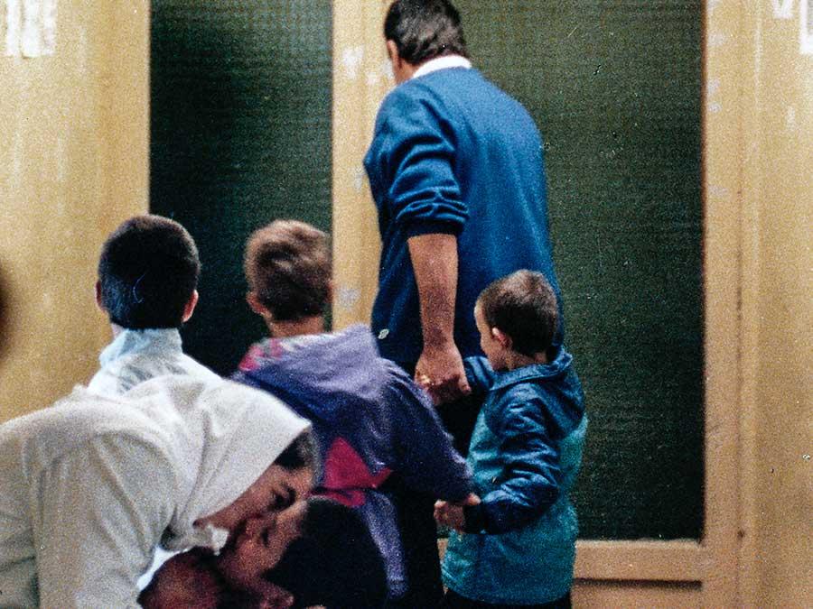 John leaving orphanage with children