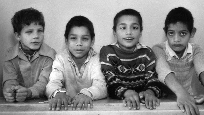 group of 4 Romanian orphans in 1990