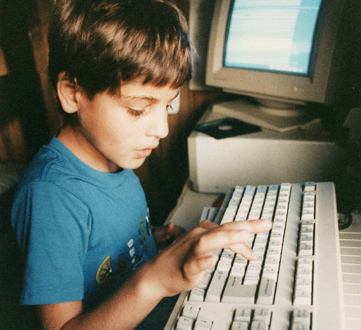 Young Izidor typing on computer